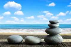 Stack of Zen pebble stones on the beach. Spa and healthcare concept Royalty Free Stock Images