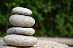 Stack of zen rocks in garden Royalty Free Stock Photography