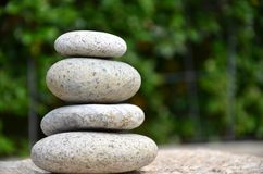 Stack of zen rocks in garden Royalty Free Stock Photo