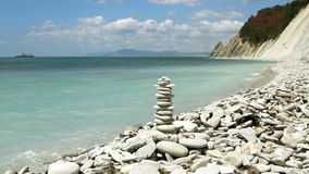 Stack of zen stones. On the beach stock footage
