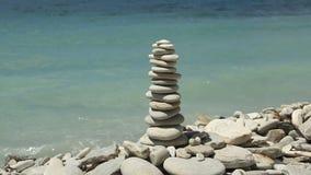 Stack of zen stones on the beach stock video