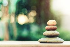 Stack of zen stones on ground with blurred nature background. Abstract background, yoga and meditation stock image