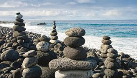 Stack of zen stones over water and blue sky. Shallow depth of fi. Eld. Canary Islands Stock Image