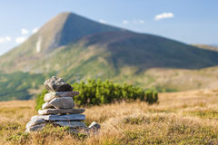 Stack of zen stones overlooking the top of mountain. Concept of Stock Image
