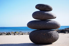 Stack of zen stones on the sand Stock Photo