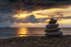 Stack of zen stones at sunset Royalty Free Stock Images
