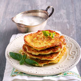 Stack of zucchini and feta fritters on plate Royalty Free Stock Photography