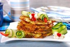 Stack of zucchini and potato pancakes Stock Photo