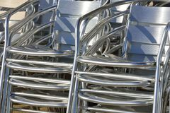 Stacked aluminium chairs in close up. Stacked empty  aluminium chairs  in close up Royalty Free Stock Photography