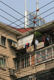 Stacked apartments and tangled power lines in fast growing Shanghai royalty free stock images