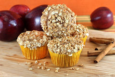 Stacked Apple Bran Muffins. Stacked apple bran and granola muffins with apples and cinnamon sticks Royalty Free Stock Photography