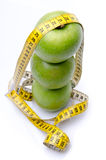 Stacked apples with a tape measure Royalty Free Stock Images