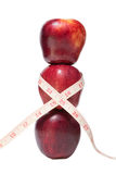 Stacked apples with a tape measure Royalty Free Stock Photos