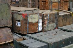 Stacked army boxes 7. Stacked army boxes ready for transportation Stock Photo