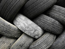 Stacked artfully tire wall. Old tires, stacked artfully wall decoration Stock Images