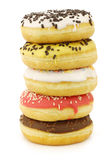 Stacked assorted colorful glazed donuts Royalty Free Stock Photo