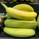 Stacked bananas in varying stages of ripeness stock image