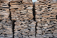 Stacked bark of cork oak. Stacked bark of cork in a factory in Portugal in the region of Alentejo. Portugal is the worlds biggest producer of natural cork stock images