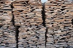 Stacked bark of cork oak stock images