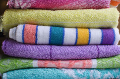 Stacked bath towels close up. Stacked or pile of bathroom towels in rainbow colors Royalty Free Stock Photo