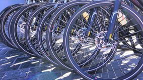 Stacked bicycle tires on street stock images