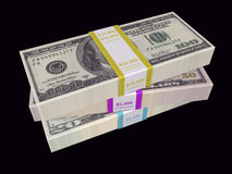 Stacked bills on black background Royalty Free Stock Photos