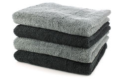 Stacked black and grey bathroom towels Royalty Free Stock Photography
