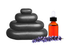 Stacked black stepping stones, essential oil and lavender flower. S on white background Royalty Free Stock Images