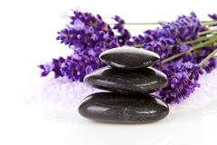 Stacked black stepping stones and lavender flowers. Stacked black steping stones and lavender flowers over white background Royalty Free Stock Photography