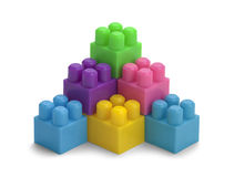 Stacked Blocks. Toy Pastic Block Pyramid Isolated on a White Background Royalty Free Stock Photo