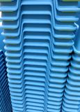 Stacked Blue Plastic Chairs. Closeup Stacked Blue Plastic Chairs Stock Image