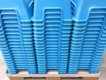 Stacked Blue Plastic Chairs. On a Pallet Royalty Free Stock Photos