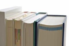 Stacked books. On white background Stock Photo