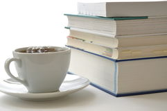 Stacked books. And hot coffee Royalty Free Stock Photos