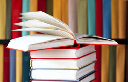 Stacked Books And Bookshelves Royalty Free Stock Photography