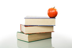 Stacked books and apple Royalty Free Stock Photo