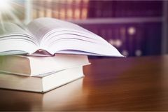 Stacked new books on wooden table. Stacked books background paper art abstract brown Stock Image
