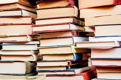 Stacked books background. Plies of books royalty free stock photos