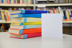 Stacked books. Books in the library. Pile of books. Colorful books. Blank card. Insert your own text. Stock Photo