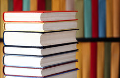 Stacked books and bookshelves Royalty Free Stock Photos