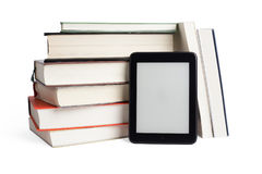 Stacked books and ebook device with blank screen Stock Images