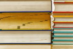 Stacked books have a variety of Vintage colors. royalty free stock images