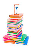 Stacked books and hourglass Royalty Free Stock Photo