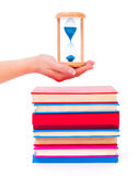 Stacked books and hourglass Royalty Free Stock Image