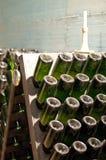 Stacked bottles full of wine Stock Image