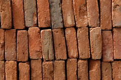 Stacked bricks. A pile of stacked bricks royalty free stock photography