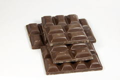 Stacked Broken Slab of Dark Chocolate Squares Stock Images