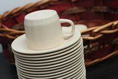 Stacked brown empty teacups at a function Stock Images