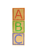 Stacked brown wooden ABC letter cubes Stock Photos