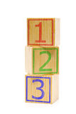 Stacked brown wooden cubes with numbers one, two and three Stock Photography